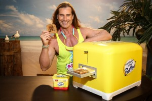 Fabio holding toast from a large toaster for I Can't Believe It's Not Butter commercial
