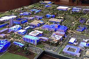 Movie prop of BYU campus diorama lit blue